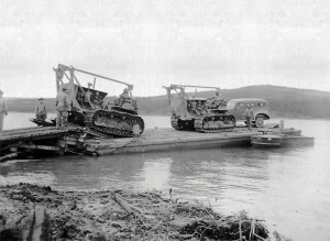 Company C, 93rd Engineers, loaded equipment on a barge, crossed Nisutlin Bay and began improving the pioneer trial of the 340th Regiment. 1942