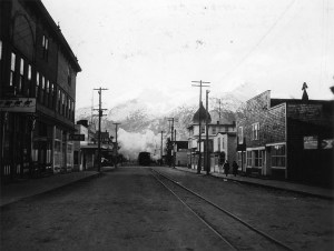 Train tracks run down Broadway Street in the city of Skagway, Alaska. 1942