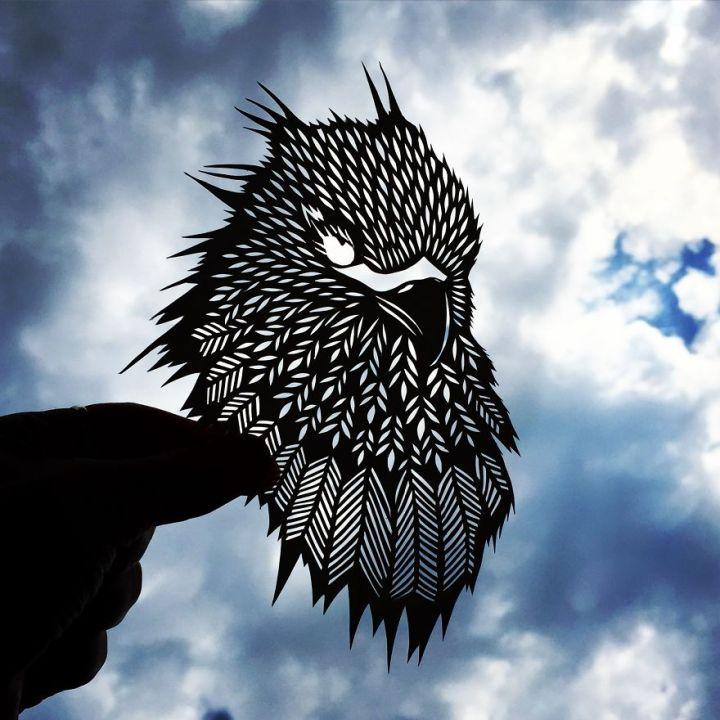 Bird paper cut art by Jo Chorny