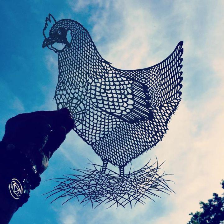 Chicken paper cut art by Jo Chorny