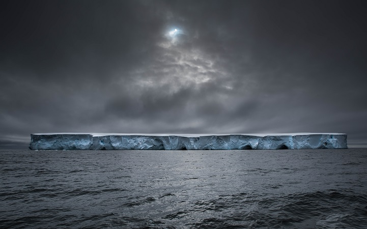 Last December i sailed to Antarctica on a 54 feet long-haul steel vessel . As we entered the Polar Zone this was one of the first icebergs we saw. Sculpted by the wind and waves, majestic in scale and with a dazzling white colour with layers of deep blue. The sun makes a quick appearance through a hole in the clouds, just in time for this shot.