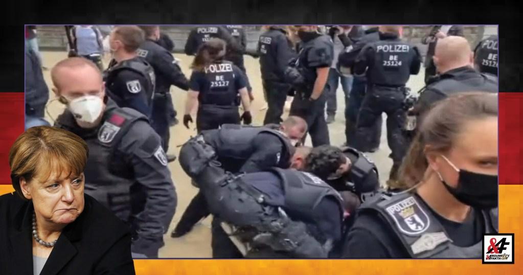 """""""Zastavte tu koronavirovou lež!"""" """"Máme právo na důstojný život!"""" Děsivé záběry z Německa. VIDEO. Brutální zatčení vůdce demonstrace. Vodní děla, psi, německé povely, policie v drtivé přesile 10 na jednoho. Přibývá útoků na novináře"""