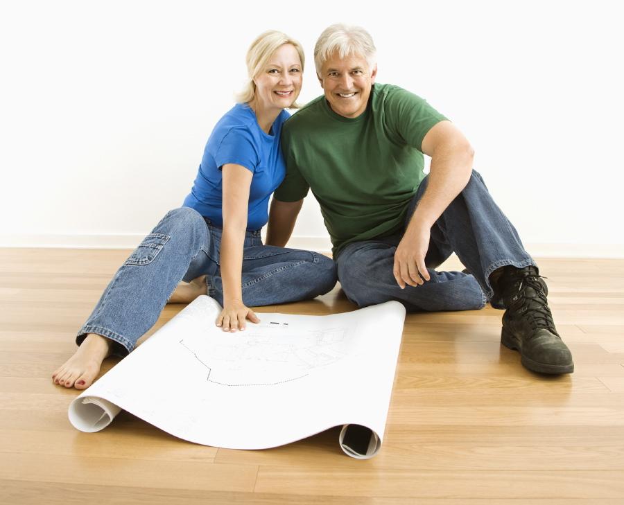 Couple reviewing building plans