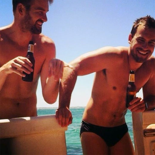 Having a beer in speedos