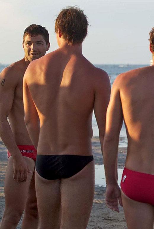 Guys in Speedos on the Beach