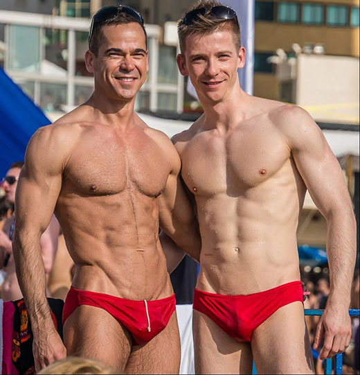 Guys in red speedos