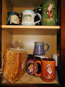 Jerry's cupboard. On our annual trips to Disneyland, we always buy coffee cups. Jerry likes Grumpy. The bread is Jerry's.