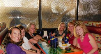 My Hoodettes, my girlfriends in my Sisterhood Support Group. Clockwise on right: me, Julie, Aubrey, Jennifer, Sherlyn, and Phyllis. Missing from the photo is April who is starring in a musical we plan to attend after this dinner, and Nancy who is in Yellowstone.