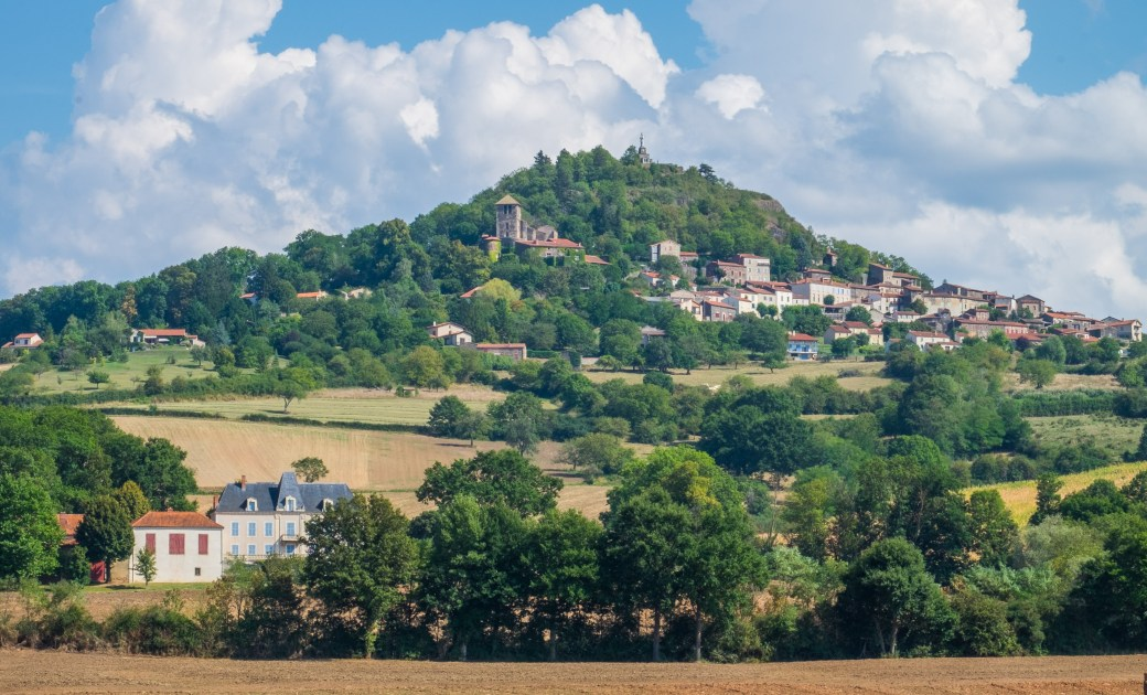 Usson, perched on a volcanic butte further south in the Auvergne, is a member