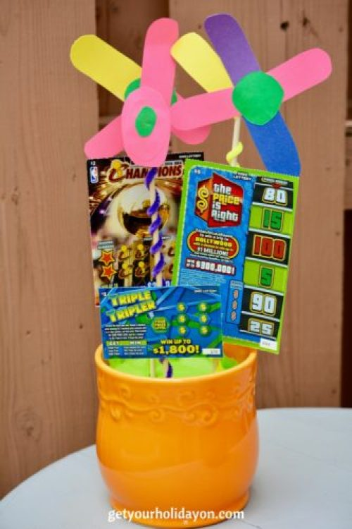 Cute and Unique Idea from get your holiday on. A DIY Lottery Ticket Flower Arrangement made especially with fun. Great idea for a mom, birthday, Anniversary, or another special occasion.