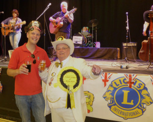 Howling and Dan Franklin (one of Fleet Lions' Ale Festival organisers) with the Stomping Nomads in the background.