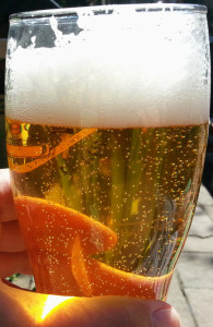 So clear you can see the fingers through the glass, lively as well with a nice head.