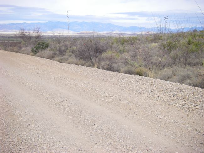 gravel dirt road in New Mexico with a scenic view