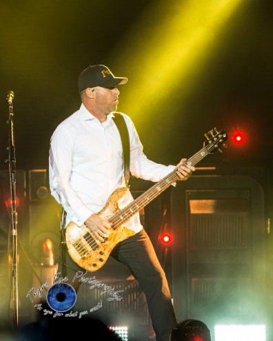 Mike Kroeger of Nickelback performing at Hollywood Casino Amphitheatre in Saint Louis. Photo by Sean Derrick/Thyrd Eye Photography.