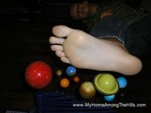 Isaac's feet compared to the solar system
