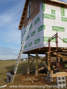 Putting housewrap on our small cabin