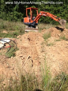 Digging a footer with an excavator