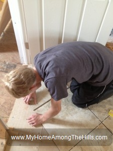 My son installing ceramic tile