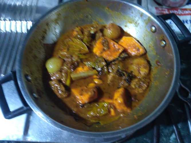 12. Mix and cook with lid on for 15 minutes on low heat. Cook till mango shrinks and softens more. Add Jaggery (gor) and Vinegar (Kolah) for Sweet and Sour taste. Khatta Mitha Taste!