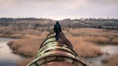 above-ground-pipeline-man-walking-inroads