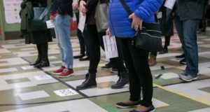 elections canada poll line ups inside poling place