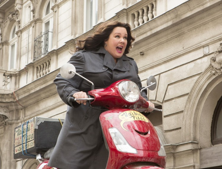 In SPY Susan Cooper (Melissa McCarthy) races to stop a deadly arms dealer. Photo: Fox Home Entertainment Insiders