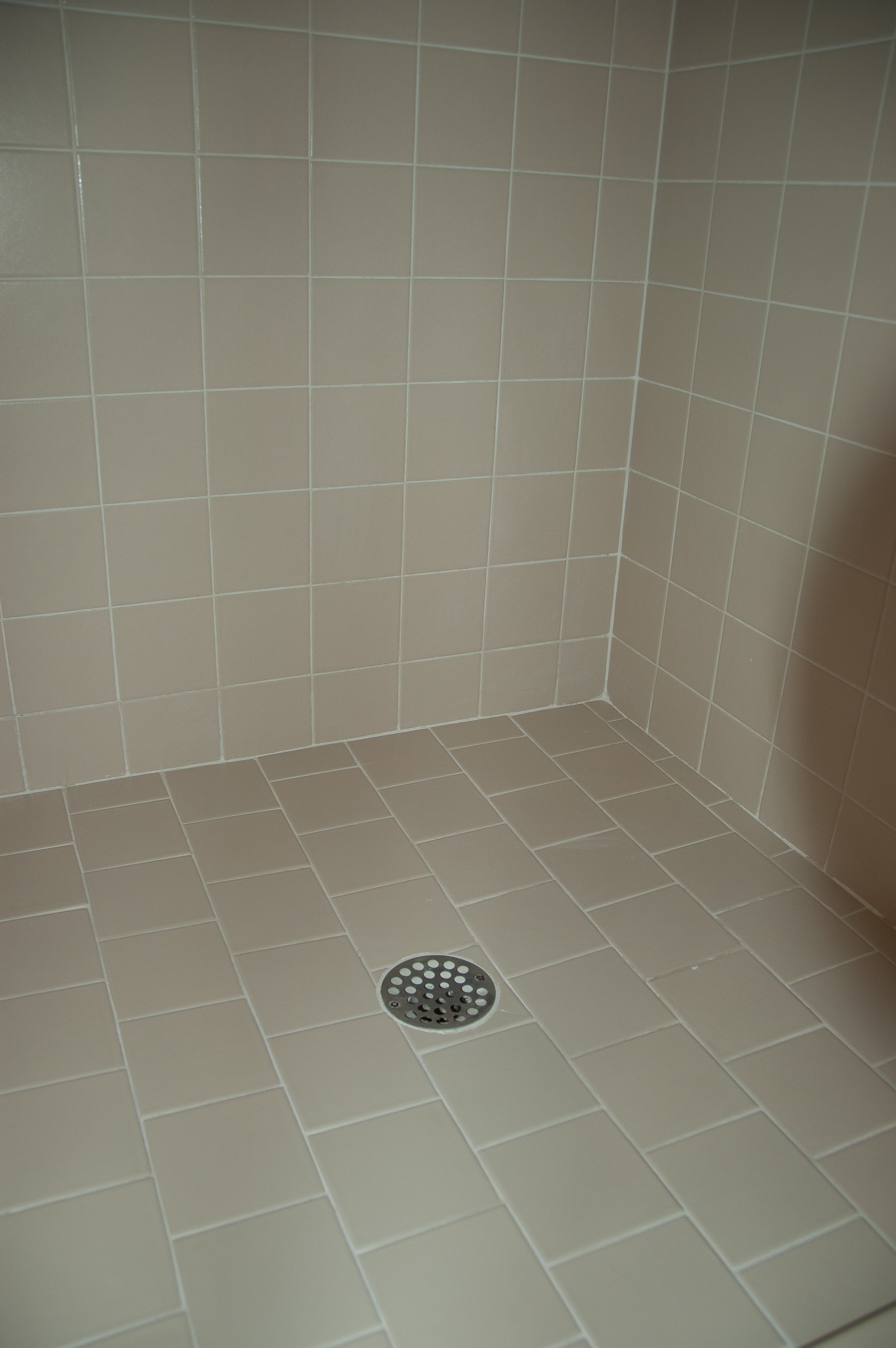 Shower stall re-grout and re-caulk project - The DIY Girl