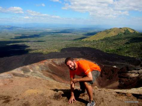 View from the top of the volcano; it almost doesn't look real. That hole behind me would be quite a drop!