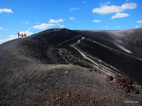 hiking up the edge of a volcano, before boarding down. There's no rails or trails here!