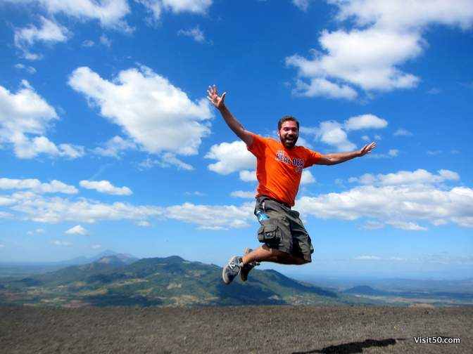 Volcano jumping! That's the edge of the cliff of Cerro Negro Volcano below me