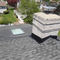 repair of a roof and skylight