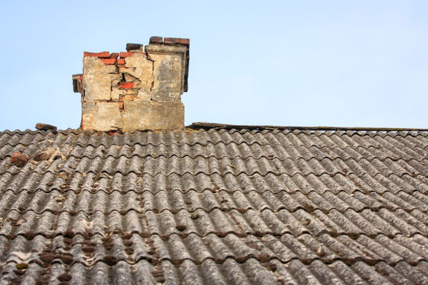 Old cracked chimney on an old roof