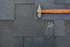 shingles on the roof with regular hammer