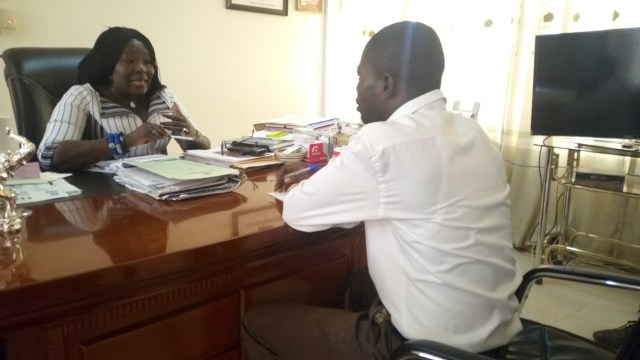 Upper East Regional Minister, Paulina Patience Abayage with Joshua Asaah