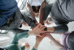 low-angle-photo-of-people-holding-hands-together-3931604