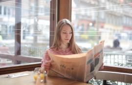 woman-in-pink-long-sleeve-shirt-reading-the-newspaper-3928118