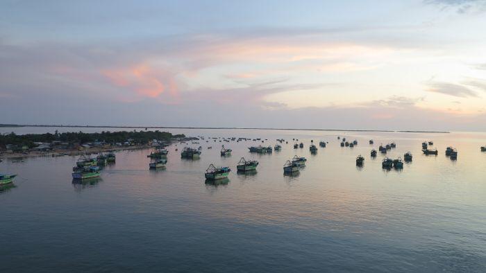 fishing boats in the sea sun set