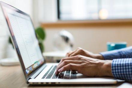 man using Xero on laptop