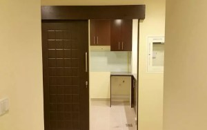Semi solid wooden sliding door with kitchen wall partition in Dubai