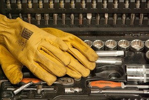 Image or yellow gloves on an open tool box