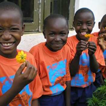 students smelling flowers and smiling