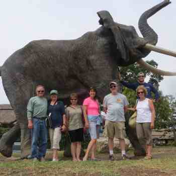 trip group with elephant statue