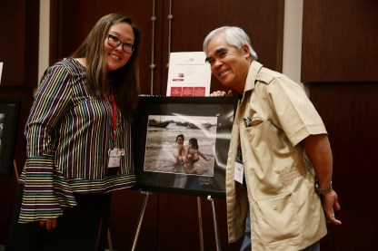 Nick's photo that Doris bought in the Silent Auction with Doris Truong and Nick Ut. Photo by Alex Wong