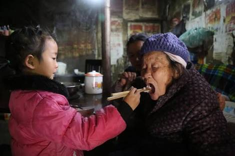5 year old china girl do all household chores and takes care of her grandmother