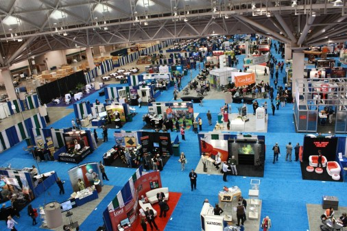 Image: an aerial shot of the MuseumExpo showfloor with many exhibitor booths arranged in a grid