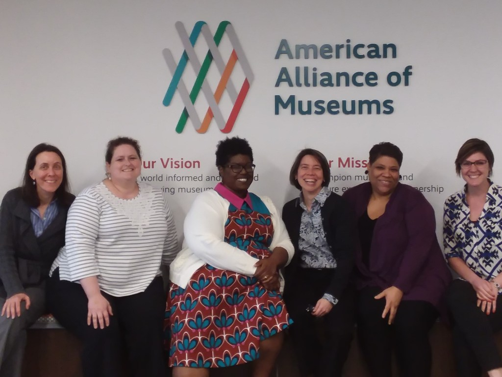Image of six women sitting in front of the American Alliance of Museums logo