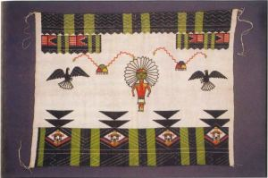 Native textile with a humanoid figure and birds.
