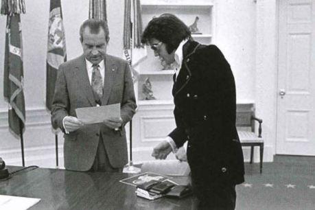 Two men talking in the oval office.