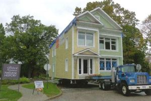 Image of a house on a flatbed truck.