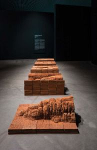 Interior view of an art installation showing erosion of different elements.